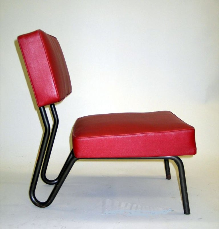 Rare, chic pair of early French industrial Mid-Century Modern lounge / slipper chairs in tubular metal and red skai designed for the Paris headquarters of EDF-GDF by Jacques Hitier for Tubauto. 