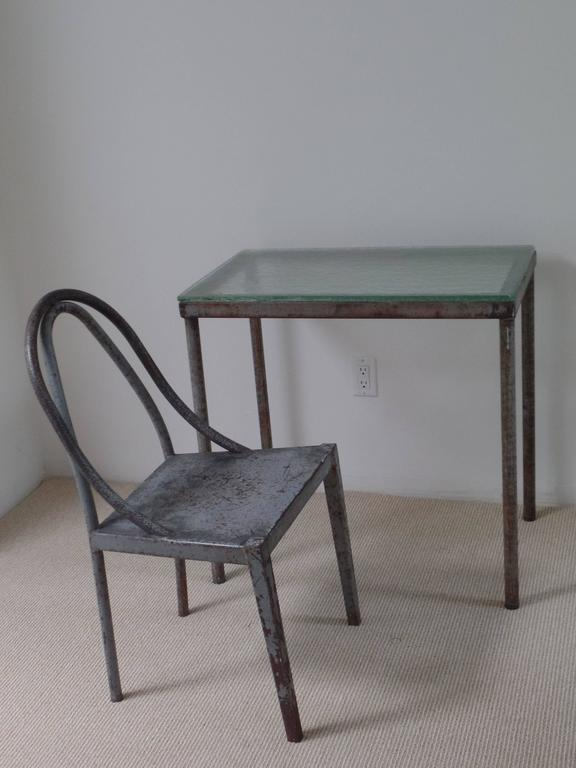 Rare handmade French modernist desk and chair prototypes in hand-formed and hand-hammered (non-commerially produced) tubular steel. The chair and desk are elegant architectural statements in their form and lines. Original top of sand-cast and steel
