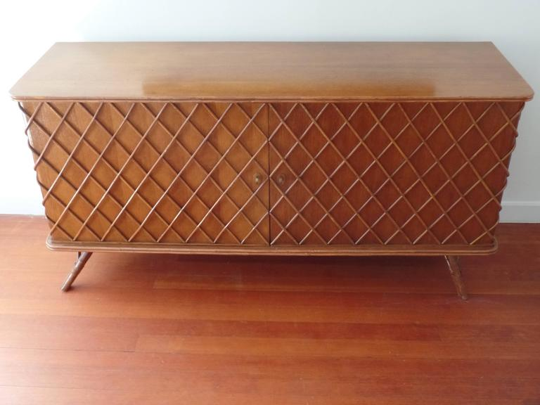 A rare French Mid-Century Modern sideboard, credenza or cabinet by Jean Royere, circa 1940-1950.