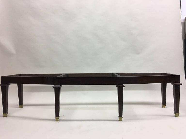 A French Mid-Century Modern Neoclassical Bench attributed to Andre Arbus.   The bench is shown without upholstery and is elegantly bowed in the center. Depth is 16