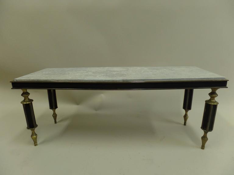 A rare French Mid-Century coffee table in the modern neoclassical style attributed to Gilbert Poillerat.