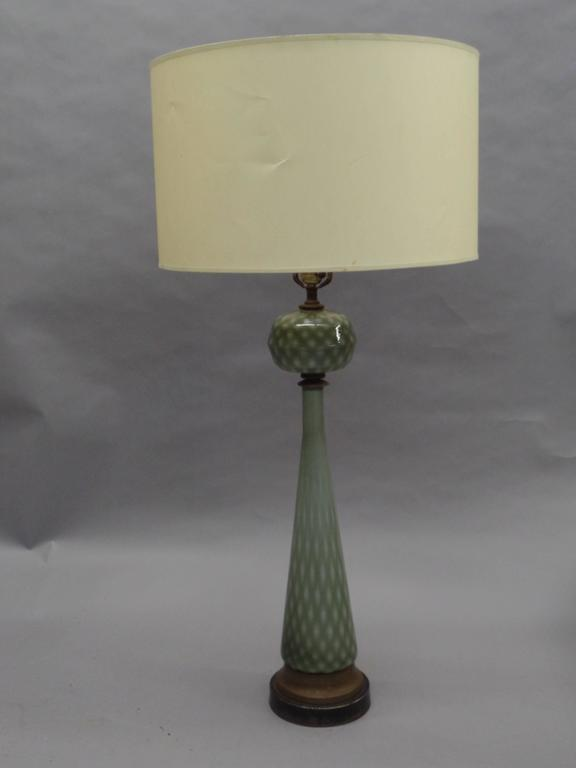 Pair of rare Italian Mid-Century handblown Venetian glass table lamps attributed to Barovier e Toso. Their unusual form has both a modern and neoclassical appeal.  Height shown is 43