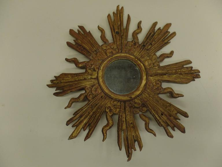 Rare French modern neoclassical style sunburst wall mirror composed of gilt lead.