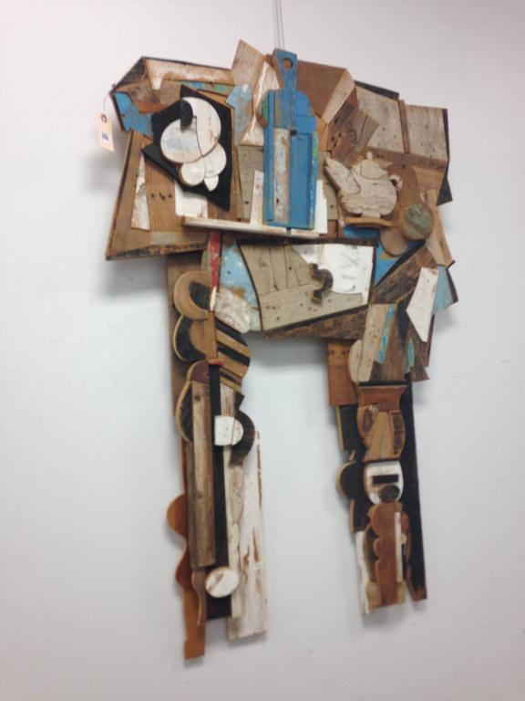 Abstract wood wall sculpture by Italian artist and designer, Felice Antonio Botta.  Botta was an early proponent of used 'poor materials' (recovered and found wood) for a movement that became known as arte povera (poor art). In this piece his