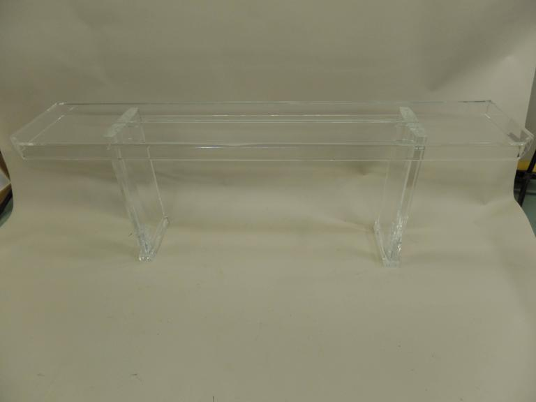 Chic Pair of French Mid-Century Modern sofa tables or consoles in plexi-glass featuring a totally modern, transparent look with both bases and tops all in Lucite.  Priced and sold by the individual piece.