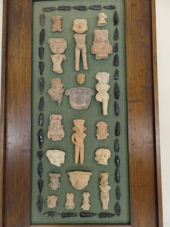 Incredible collection of pre-columbian clay sculptures / figures / statues / pottery, mounted and framed. The pieces date from the pre-classic (Formative) period of Meso-American cultures that inhabited present day Mexico and Guatemala.   During