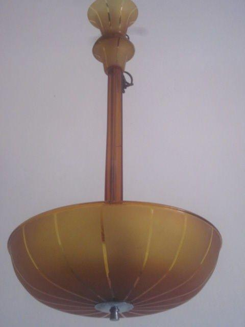 Elegant Mid-Century Modern traditional Venetian glass chandelier or ceiling fixture with amber colored sanitized glass with a simple striped pattern. Light is filtered through the glass and upward via three Edison bulbs to produce a warm