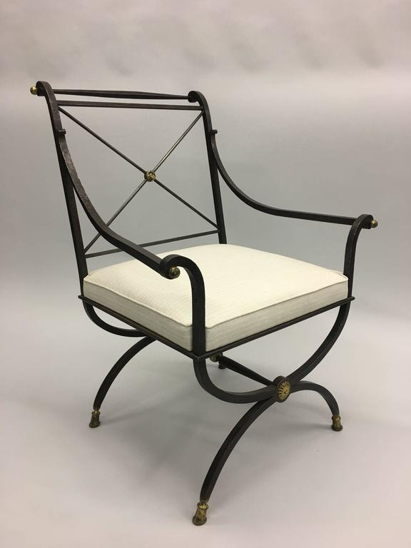 Elegant French modern neoclassical form hand-hammered wrought iron chair for desk, vanity or lounge by Gilbert Poillerat with the seat structure from a design by Andre Arbus.