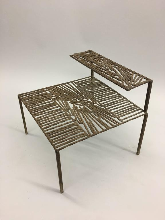 Wrought iron sculpture constructed in the form a double level table Italy, circa 1967  The top of each level is constructed as an Arte Povera / Post-Minimalist sculpture with parallel rods of iron being intercepted by diagonal