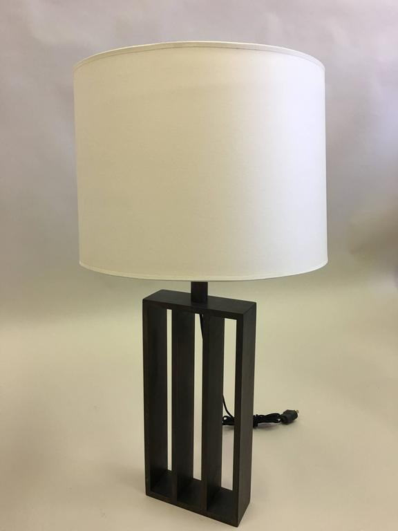 Pair of French Mid-Century Modern style wrought iron table lamps in the minimalist tradition by Thomas Gargiulo inspired by the work of French architect or designer, Jacques Quinet and the American artist, Sol Le Witt.