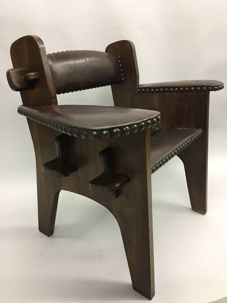 Rare, unique pair of Italian early modernist armchairs attributed to Giacomo Balla. The chairs integrate futurist aesthetics with Arts & Crafts style.  The pieces utilize typical Arts & Crafts materials. They are in solid wood with large studded