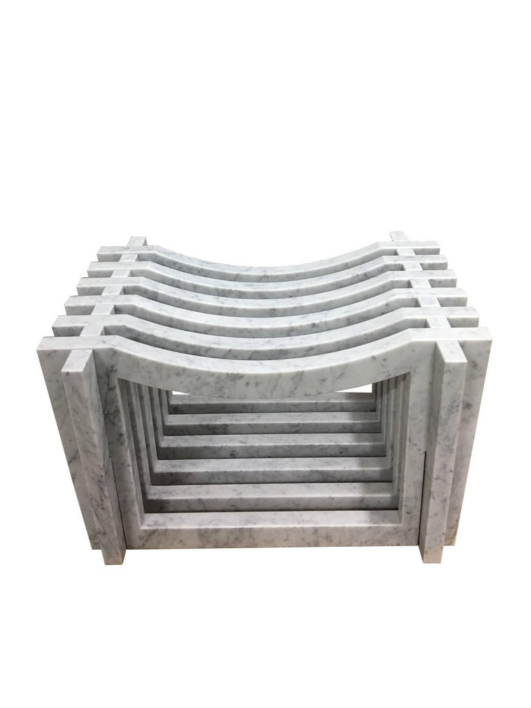 Two Italian white Carrara marble benches or stools in a Minimalist aesthetic. Ideal for bath room and shower or garden. The benches are constructed with 6 pieces of marble on 2 inter-stacked open framed marble parts that form the base. Also