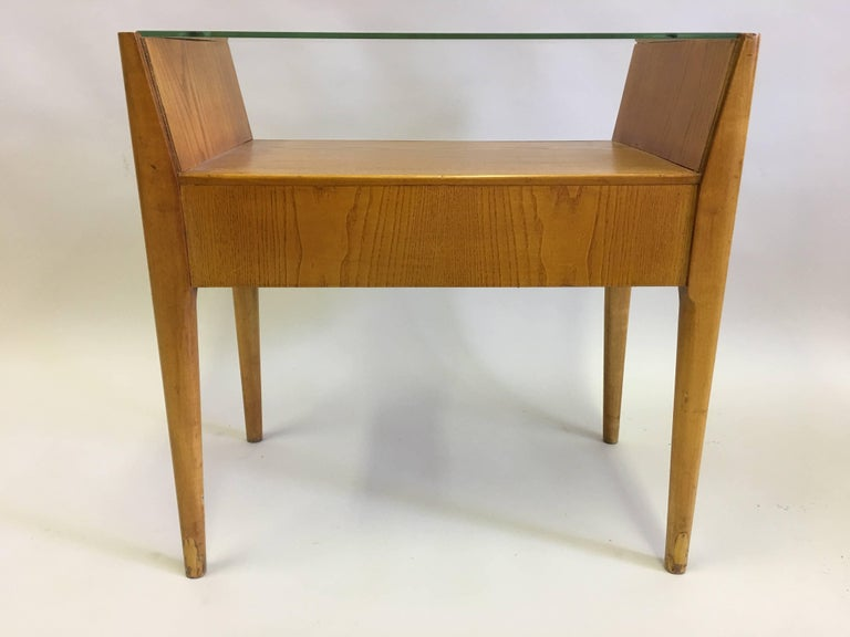 Elegant pair of Italian Mid-Century Modern double level end tables attributed to Gio Ponti. Hotel Royal Naples, circa 1954.  Solid wood (Ash) with glass tops.