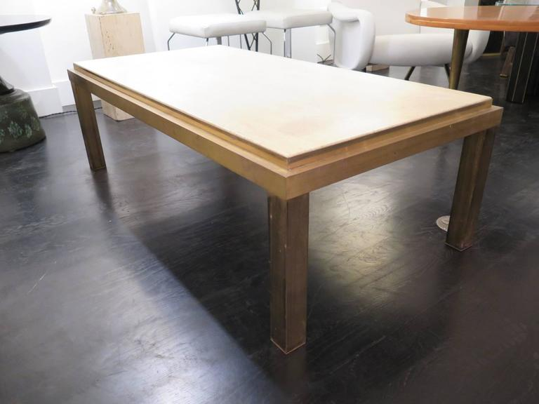 Vintage bronze table in its original condition. The travertine top is original with a crack. Price includes travertine replacement. Base finish open to customization.