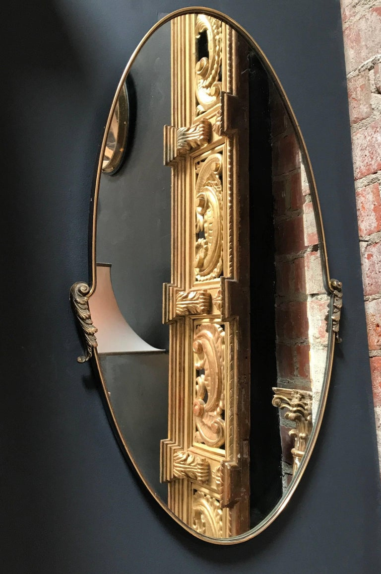 Mid-Century Italian oval mirror with brass frame, circa 1950s.
