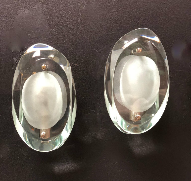 Max Ingrand for Fontana Arte glass sconces wall lamps set of four, Italy, 1960. Double lens cut panels of thick profiled polished glass with etched glass centres. Nickel-plated metal mounts. Excellent condition. The price refer to the pair.