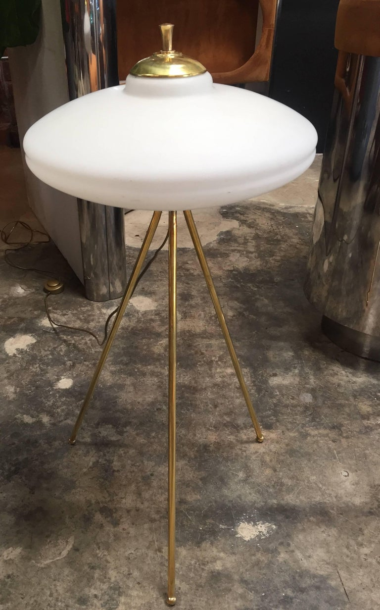 Italian tripod floor lamp is light and airy, but with a strong presence. Each of the three stems in antique brass supports a softly glowing milk glass shade, 1960s.