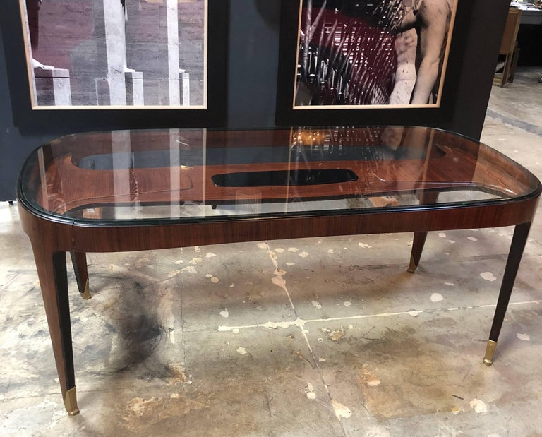 Dining or conference table by Paolo Buffa (1903–1970 Milan, Italy) . Manufactured by Serafino Arrighi, Cantù, 1940s: glass top and cherrywood in lays, and brass.  Italy, 1940s.