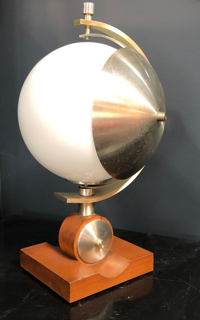 Space Age bowl table lamp with opaline white glass and metal turning part with solid wooden base. Italian turn able table lamp, metal parts, lacquered wood base and opaline glass, good conditions overall, base sizes H 2