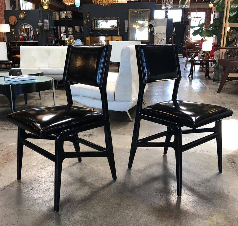Set of six iconic Gio Ponti dining chairs.