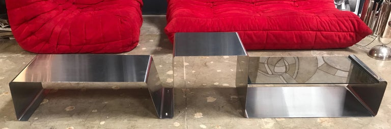 This rare and unique coffee table is made of three modular pieces: 