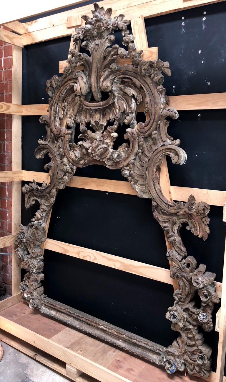 This beautiful antique frame is notable for its extremely fine hand-carved Baroque style detailing. 