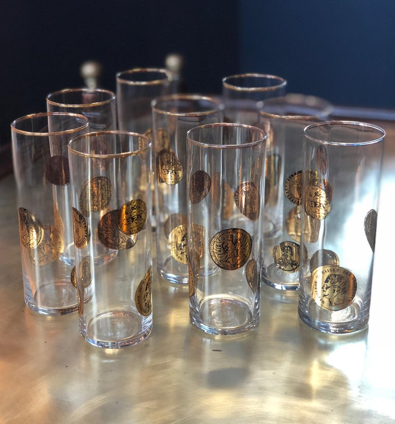 Set of nine Piero Fornasetti high glasses, Italy, 1970s Lithographically printed and handcrafted in gold-leaf.