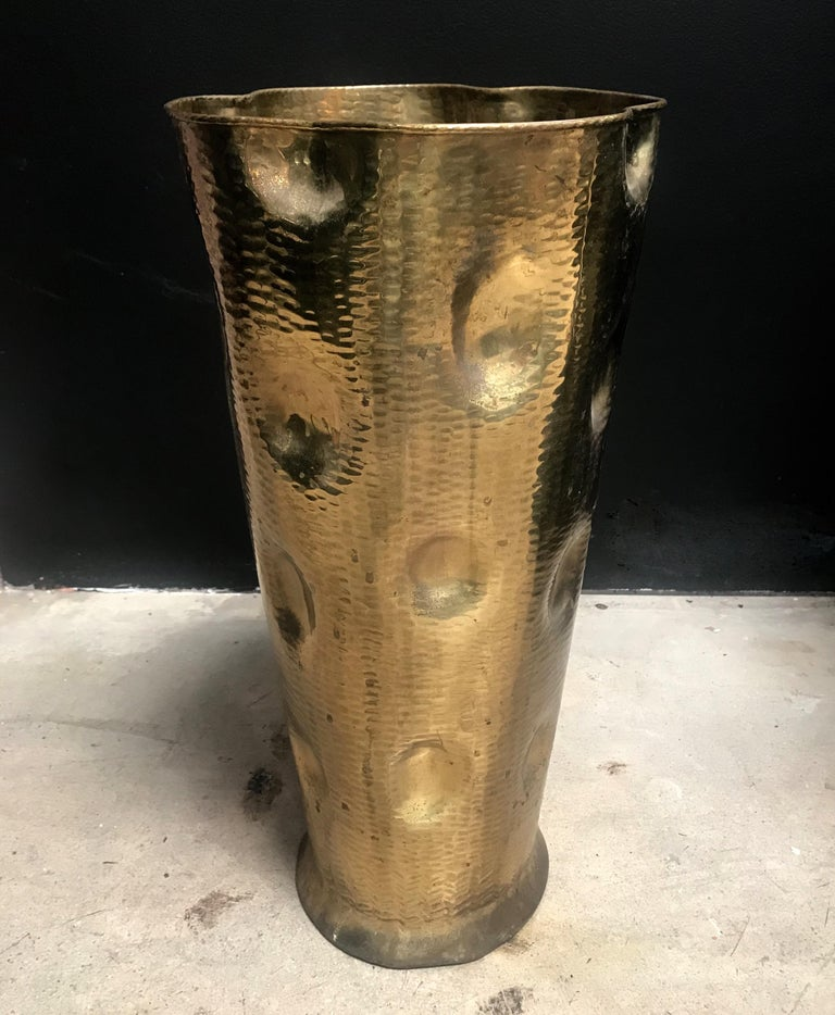 This stunning Art Deco umbrella or cane stand was handmade in Italy in the 1930s from a single sheet of brass - hammered and with unusually large depressions of the material. While the irregular and prominent surface give this object a playful and