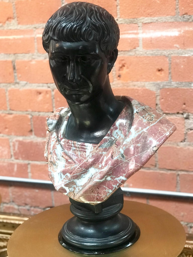 Late 1800s glazed terracotta bust and marble. Nice original patina. Emperor Augustus Caesar, Roman statesman and military leader, first Emperor of the Roman Empire, captured in an impressive bust: hand-sculpted detail of old well-patina surface,