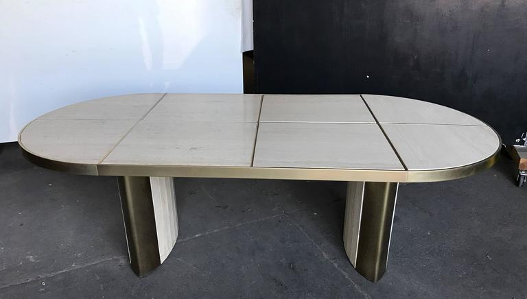 Italian travertine marble oval dining table, 1970.