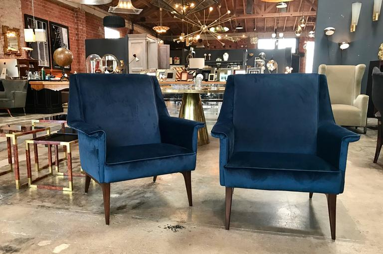 Super sexy savvy Italian 1960s pair of blue armchairs.