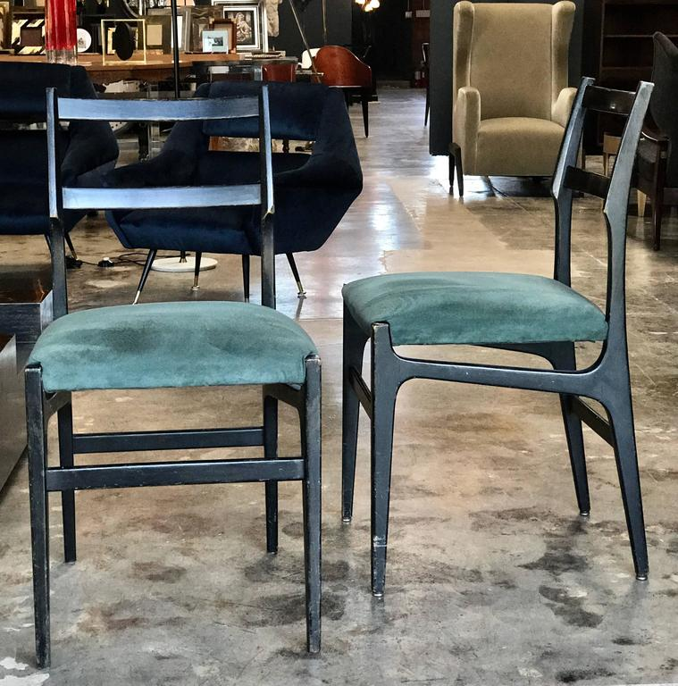 Pair of Gio Ponti leggera dining chairs with original fabric.