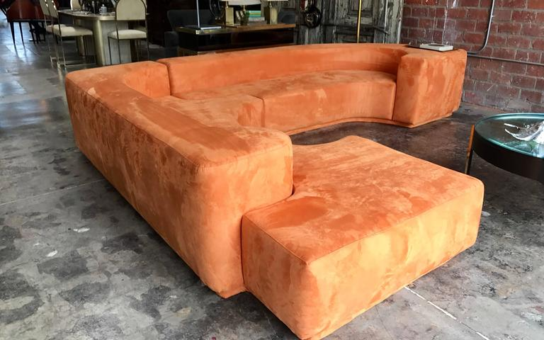 This well designed sofa is comprised of two interlocking sections with a tight seat and back. The sectional was designed in 1958 but produced in 1968. It has been reupholstered in suede.