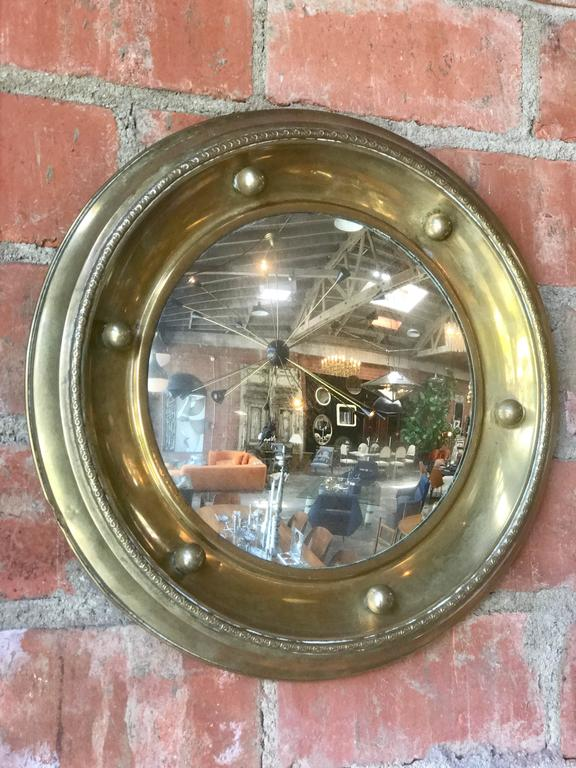 Antique brass round wall mirror.