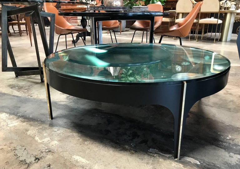 ma+39's custom black and brass magnifying lens coffee table.