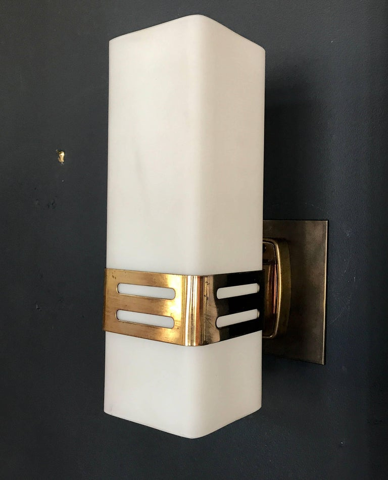 Stilnovo single sconce in opaline glass and brass band,  1950s.