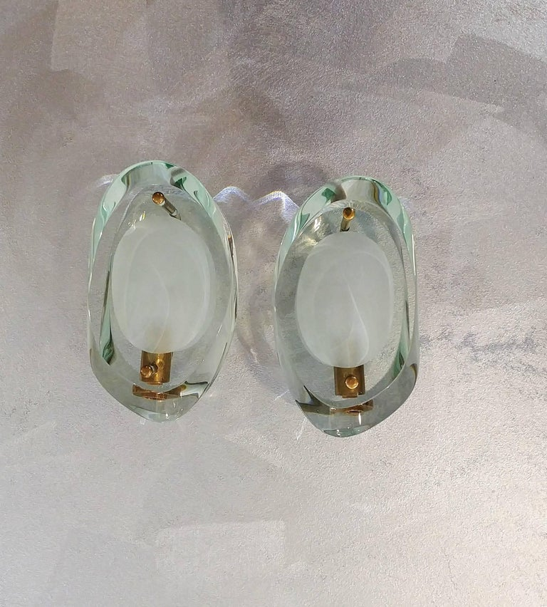 Pair of sconces in the style of Fontana Arte for Max Ingrand. Material: Nickel plated metal, Murano glass partially engraved.