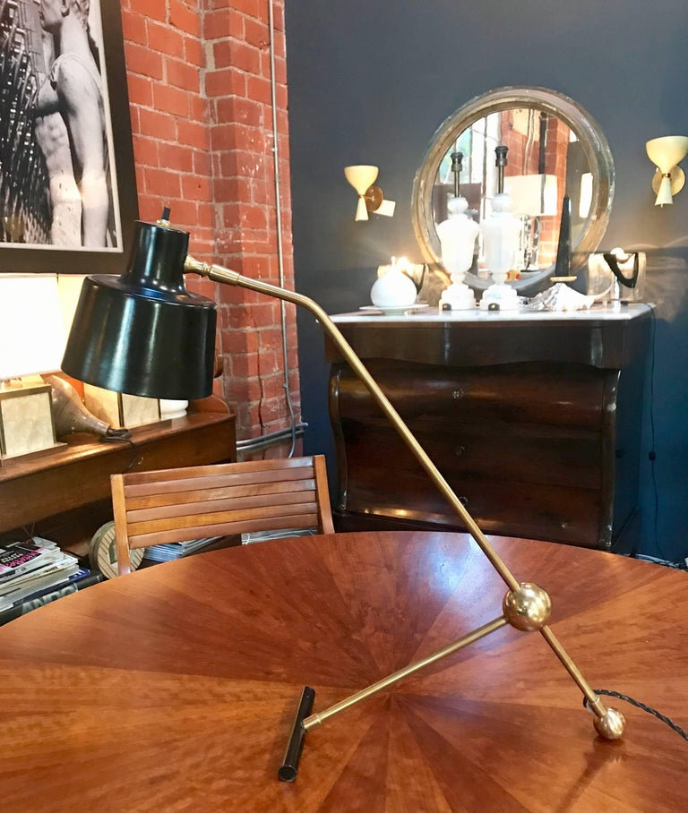 Italian adjustable table lamp in brass and metal.
