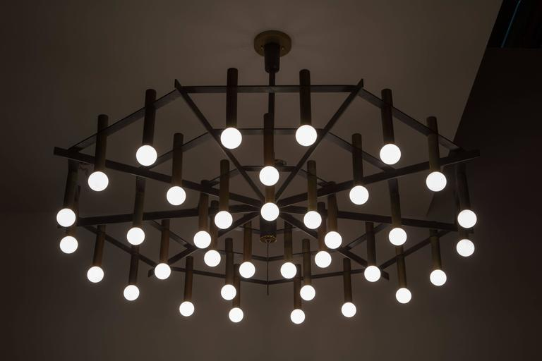 Rare and large 'Spiderweb' chandelier with newly restored sockets and wiring. Manufactured by Stilnovo in Italy circa. Wired for US junction boxes. Each socket takes one E14 European candelabra bulb. Literature: Stilnovo apparecchi per