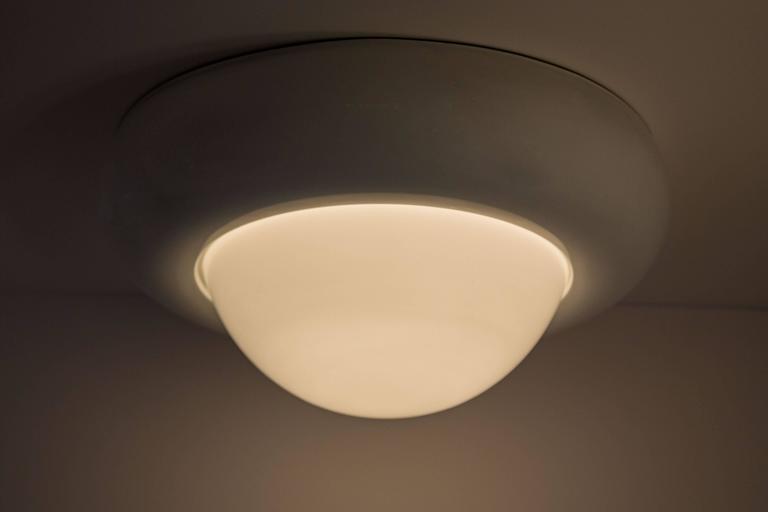 Large flush mount ceiling light with white glass globe.