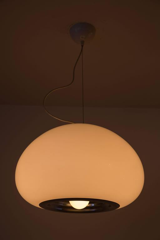Opaline glass and chrome pendants designed by Achille Castiglioni in Italy circa 1960's. Wired for US junction boxes. Each pendant takes one E27 100w maximum bulb