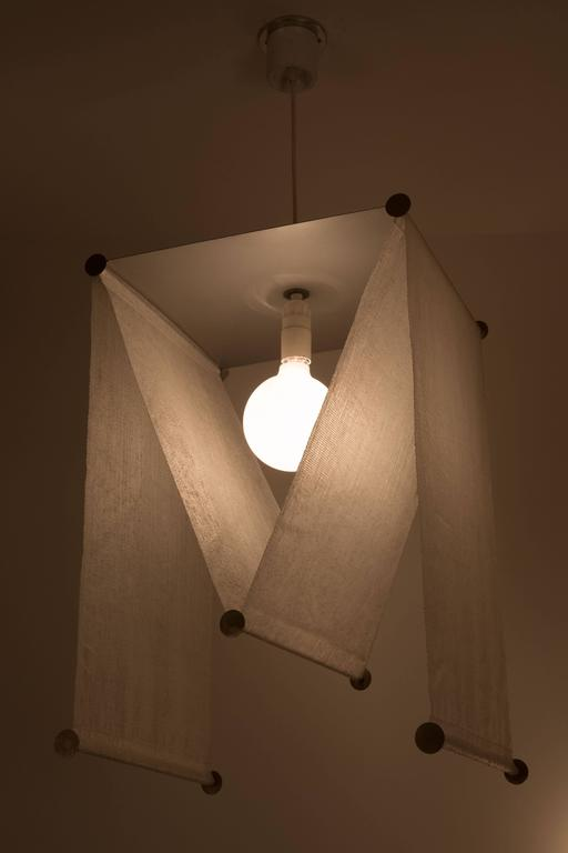 Hanging lamp designed by Achille and Pier Giacomo Castiglioni. Manufactured by Kartell prior to 1959 (Flos after 1973.) Made with varnished steel sheet, synthetic material, opaque chrome-plated steel, with an original label from Flos. Takes an E26