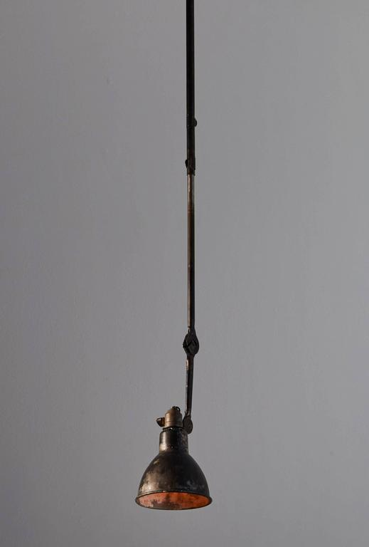 Patinated Model No. 302 Adjustable Ceiling Light by Gras Ravel For Sale