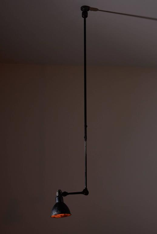 Model No. 302 adjustable ceiling light designed by Bernard Albin Gras for Gras Ravel in France, 1922. Painted steel. Original patina. Shade articulates by use of a ball pivot joint. Rewired for US junction boxes. Takes one 100w maximum bayonet bulb.