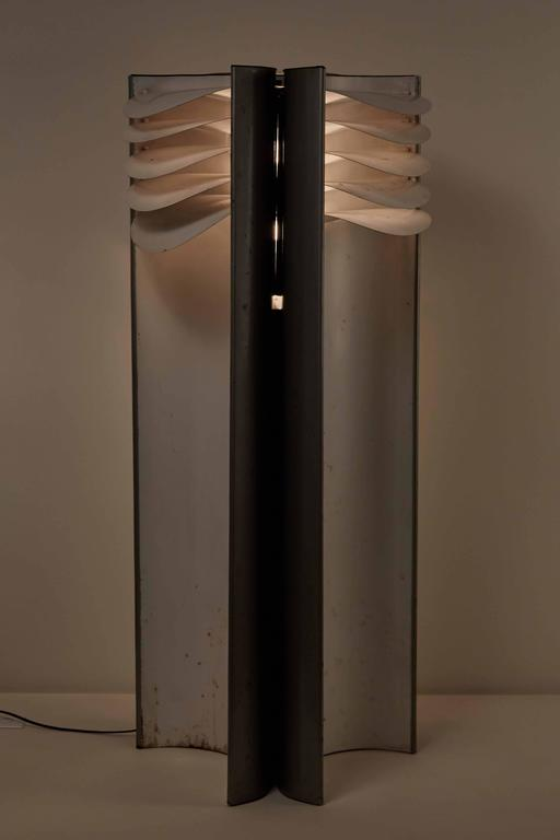 Rare Falena floor lamp designed by Mario Bellini for Candle in Italy, 1968. Indirect light formed by three large concave surfaces painted silver-grey. The light source is enclosed in the centre and reflects off these surfaces by means of an