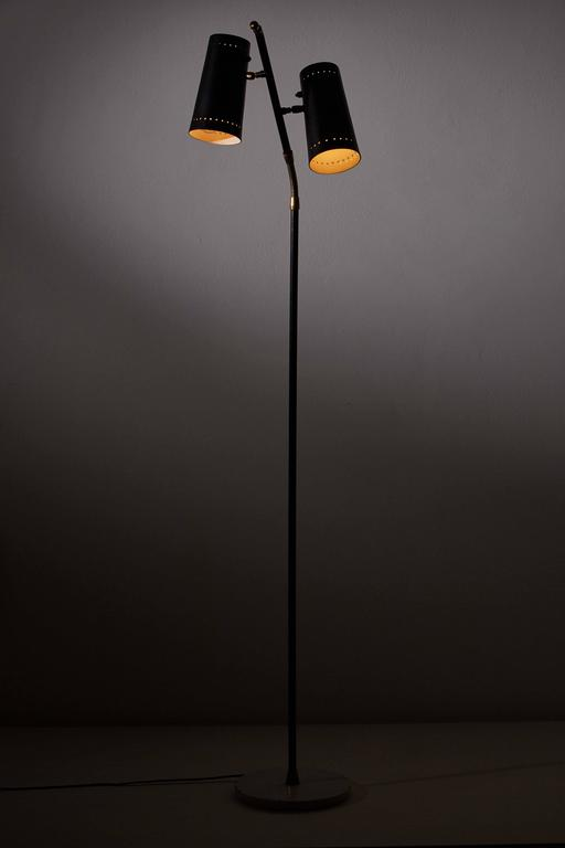Floor lamp with two pivoting shades, adjustable brass goose neck arms and marble base designed by Stilux in Italy, circa 1950s. Original cord. Takes two E27 75w maximum bulbs.