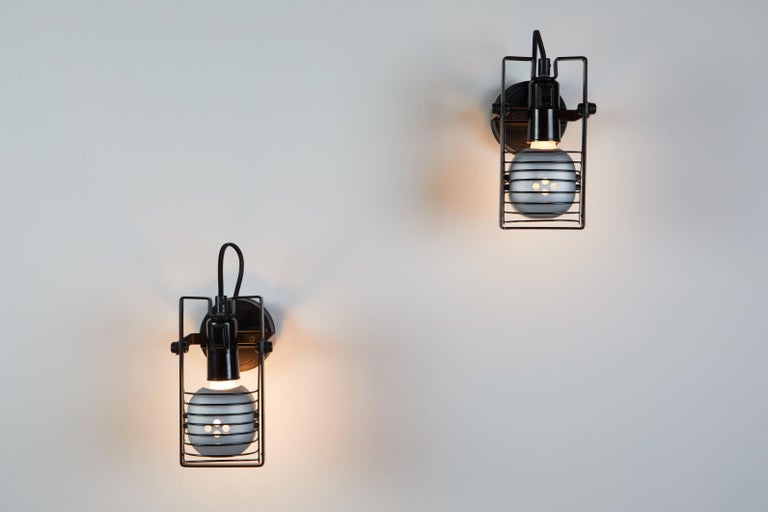 Iconic pair of original Sintesi Faretto sconces by Ernesto Gismondi for Artemide designed in Italy circa 1970s. Found in the design collection of the Metropolitan Museum in New York. Metal and acrylic.Retains original manufacturers stamp. Wired for