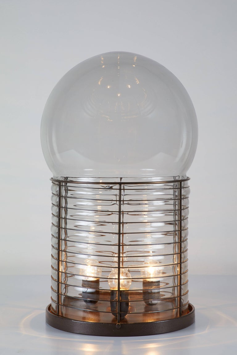 Original vintage table lamp designed by Gae Aulenti for Artemide in Italy, circa 1970. Glass diffuser with iron structure. Original cord. Takes three E27 100w maximum bulbs.