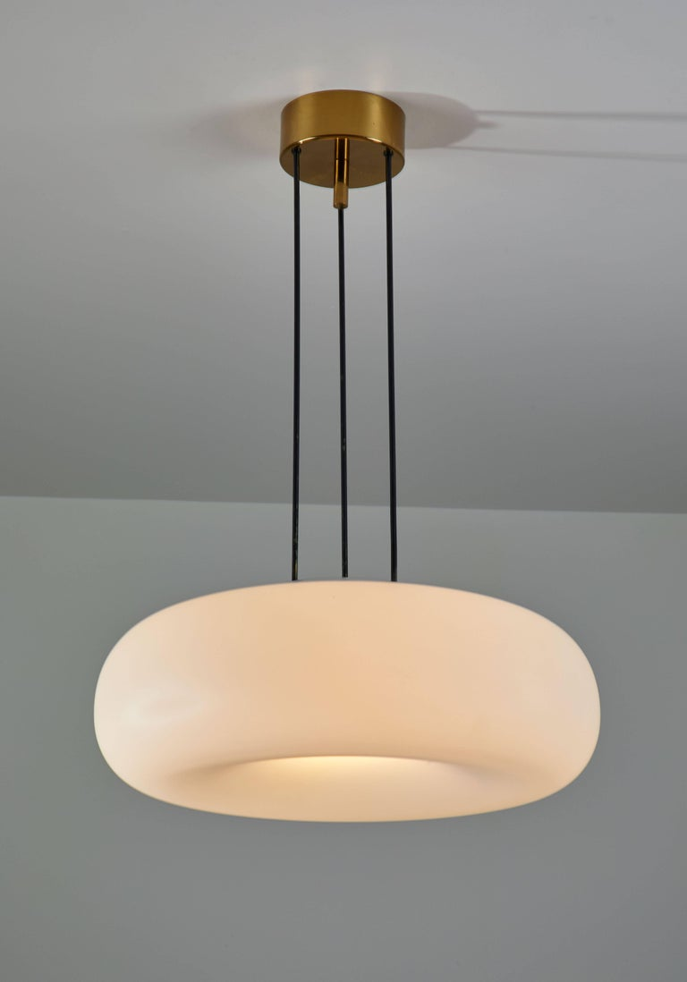 Model 2356 suspension light manufactured by Fontana Arte in Italy, circa 1960s. Enameled metal stems. Original brass canopy, brass hardware, brushed satin opaline glass diffuser. Rewired for US junction boxes. Takes four E12 40w maximum bulbs.