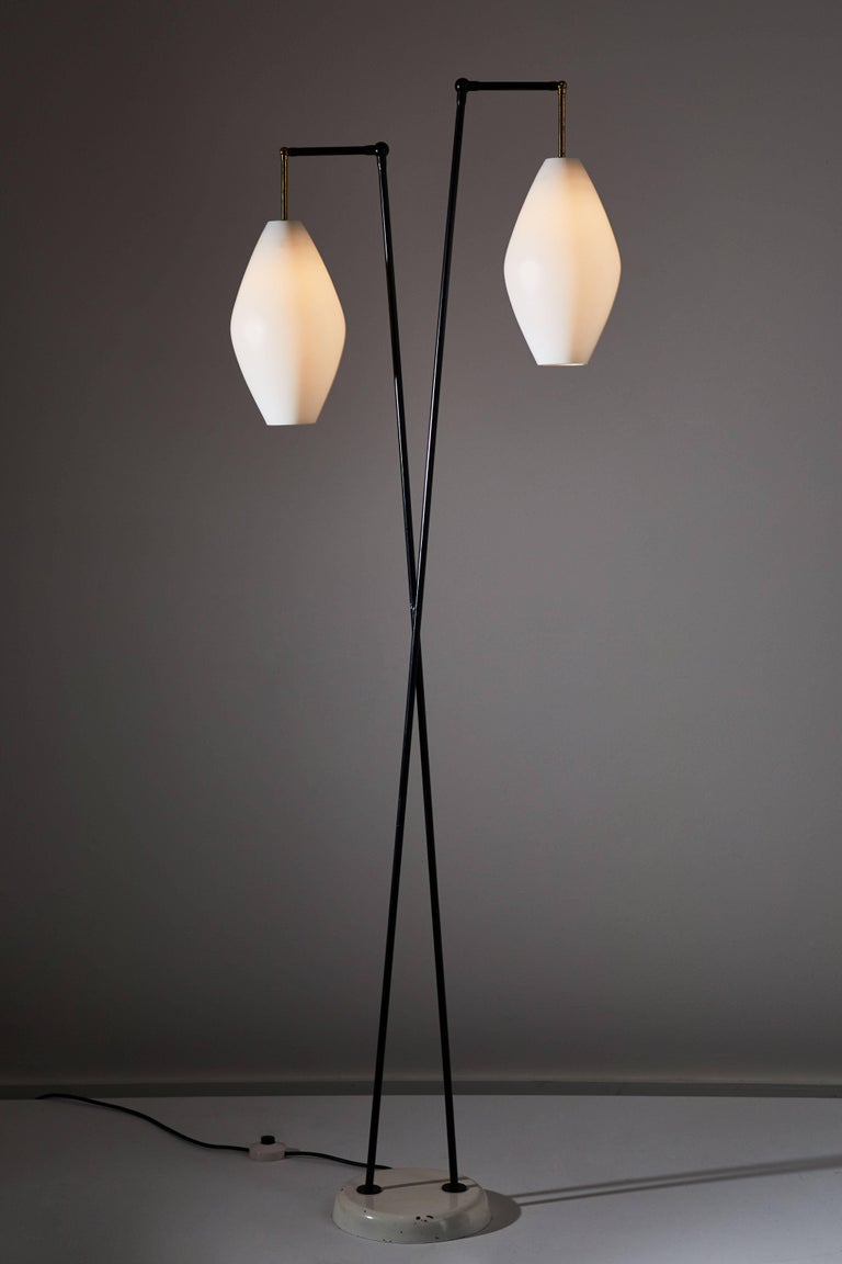 Floor lamp manufactured by Stilnovo in Italy, circa 1950s. Brushed satin glass shades, brass hardware, enameled metal stem and base. Original cord with step switch. Each shade takes one E27 75w maximum bulb.